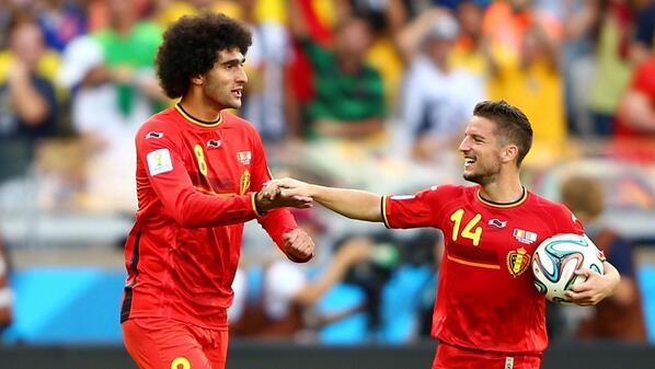 Both of Belgium's goalscorers, Fellaini and Mertens, celebrate their victory.